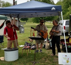 Nuclear Ukulele performing at Aurora Farmers Market