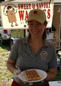 Julie Geis serving up a gluten-free waffle